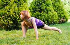 Beautiful red woman doing fitness Royalty Free Stock Photography