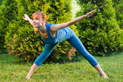 Beautiful red woman doing fitness Stock Images