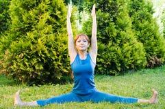 Beautiful red woman doing fitness Stock Photo