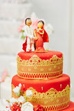 Beautiful red and yellow wedding cake in Indian style Royalty Free Stock Photos