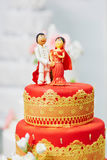 Beautiful red and yellow wedding cake in Indian style Stock Photo