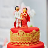 Beautiful red and yellow wedding cake in Indian style Stock Image
