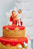 Beautiful red and yellow wedding cake in Indian style Stock Photography