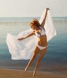 Beautiful redhair girl jumping Stock Photo