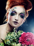 Beautiful redhair woman  holding flowers Royalty Free Stock Photography