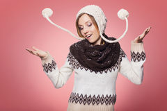 Beautiful redhair woman in winter outfit: warm sweater, scarf an Royalty Free Stock Image