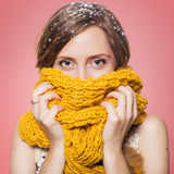 Beautiful redhair woman in winter outfit: warm sweater, scarf an Royalty Free Stock Photo