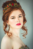 Beautiful redhaired fashion model posing in evening dress and in Stock Image