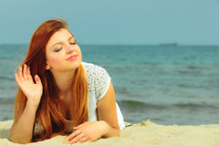 Beautiful redhaired girl on beach, portrait Royalty Free Stock Photography