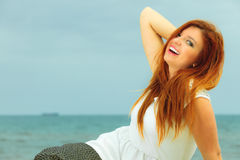 Beautiful redhaired girl on beach, portrait Royalty Free Stock Images