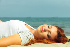 Beautiful redhaired girl on beach, portrait. Holidays, vacation travel and freedom concept. Beautiful redhaired happy girl on beach, portrait Royalty Free Stock Image