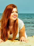 Beautiful redhaired girl on beach, portrait. Holidays, vacation travel and freedom concept. Beautiful redhaired happy girl on beach, portrait Royalty Free Stock Photo