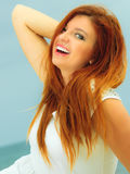 Beautiful redhaired girl on beach, portrait. Holidays, vacation travel and freedom concept. Beautiful redhaired happy girl on beach, portrait Stock Images