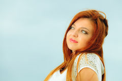 Beautiful redhaired girl on beach, portrait Stock Photos