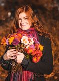 Beautiful redhaired girl with a flowers. royalty free stock photo