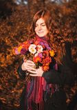 Beautiful redhaired girl with a flowers. royalty free stock photography