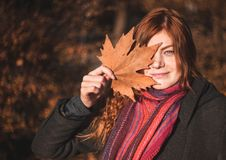 Beautiful redhaired girl with a leaf. stock image