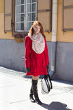 Beautiful redhaired woman walking in the street. Young beautiful redhaired woman walking in the street Stock Photos