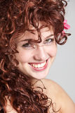 Beautiful redhead. Beautiful redhaired girl in closeup portrait smiling happily Royalty Free Stock Photos