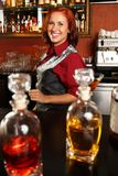 Beautiful redhead barmaid Stock Photo