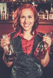Beautiful redhead barmaid Royalty Free Stock Image