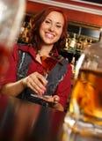 Beautiful redhead barmaid Royalty Free Stock Photos