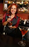 Beautiful redhead barmaid Stock Photography