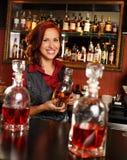 Beautiful redhead barmaid Royalty Free Stock Images