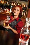 Beautiful redhead barmaid Royalty Free Stock Image