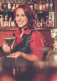 Beautiful redhead barmaid Stock Photos