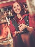 Beautiful redhead barmaid Stock Photography
