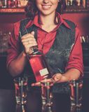 Beautiful redhead barmaid Royalty Free Stock Photography