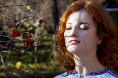 Beautiful redhead basking in the sunlight Royalty Free Stock Photography