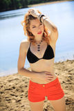 Beautiful redhead on a beach Royalty Free Stock Image