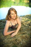 Beautiful redhead on a beach Royalty Free Stock Images