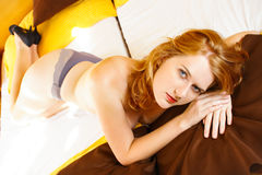 Beautiful redhead in bed Stock Image