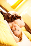 Beautiful redhead in bed Stock Photography