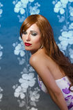 Beautiful redhead on blue vintage background Royalty Free Stock Image