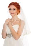 Beautiful redhead bride looking away Stock Images