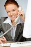 Beautiful redhead businesswoman stock photography