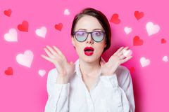 Redhead businesswoman with abstract hearts Royalty Free Stock Photography