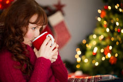 Beautiful redhead drinking hot drink at christmas Stock Photography