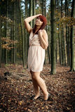 Beautiful redhead in a forest Stock Photography