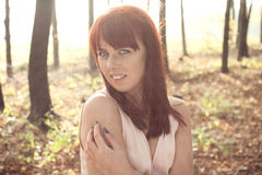 Beautiful redhead in a forest Royalty Free Stock Images