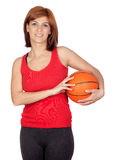 Beautiful redhead girl with a basketball Stock Image