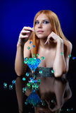 Beautiful redhead girl with blue gel balls Royalty Free Stock Photo