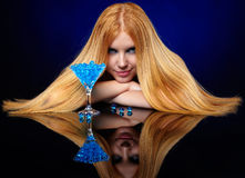 Beautiful redhead girl with blue gel balls Stock Photography