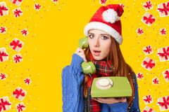 Beautiful redhead girl in christmas hat Stock Photography