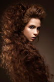 Beautiful redhead girl with curls and classic make-up. Beauty face. Photo was made in studio Royalty Free Stock Photos