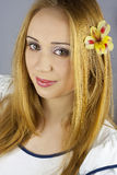 Beautiful redhead girl with flower in her hair Stock Image
